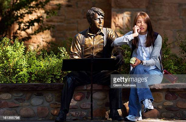 TALKKathy <cq> Rooks <cq> a freshman engineering major talks on her cell phone next to a bronze sculpture of poet Robert Frost by George Lundeen at...