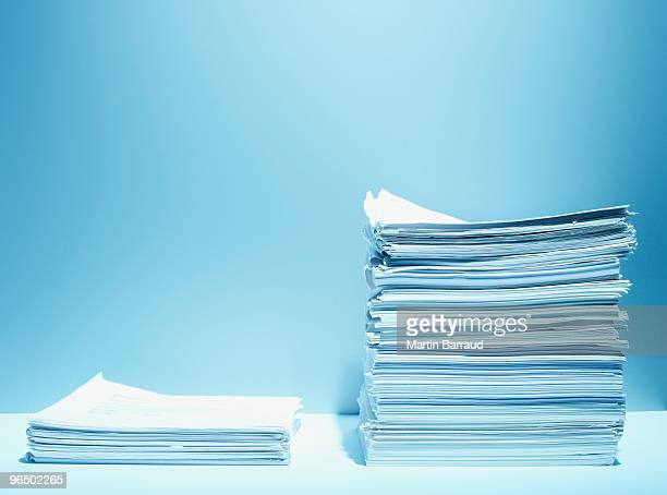Tall and short stacks of paper