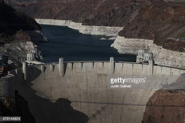 A tall bleached 'bathtub ring' is visible behind the Hoover Dam on May 12 2015 in Lake Mead National Recreation Area Arizona As severe drought grips...