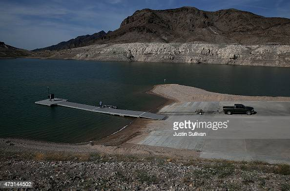 A tall bleached 'bathtub ring' is visible on the rocky banks of Lake Mead near the Echo Bay boat launch on May 12 2015 in Lake Mead National...
