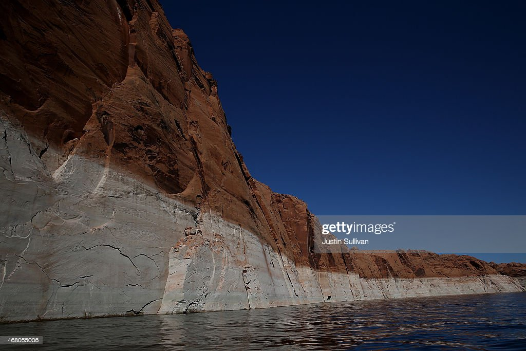 A tall bleached ''bathtub ring'' is visible on the rocky banks of Lake Powell on March 29 2015 in Page Arizona As severe drought grips parts of the...