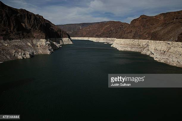 A tall bleached 'bathtub ring' is visible on the steep rocky banks of Lake Mead near the Hoover Dam on May 12 2015 in Lake Mead National Recreation...