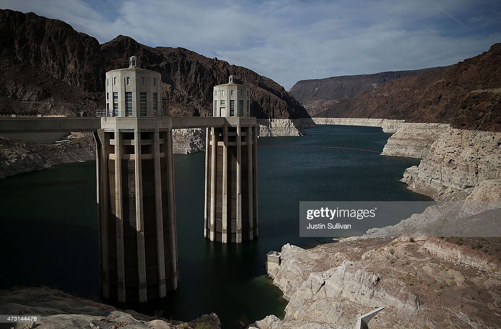 A tall bleached 'bathtub ring' is visible on the steep rocky banks of Lake Mead at the Hoover Dam on May 12 2015 in Lake Mead National Recreation...