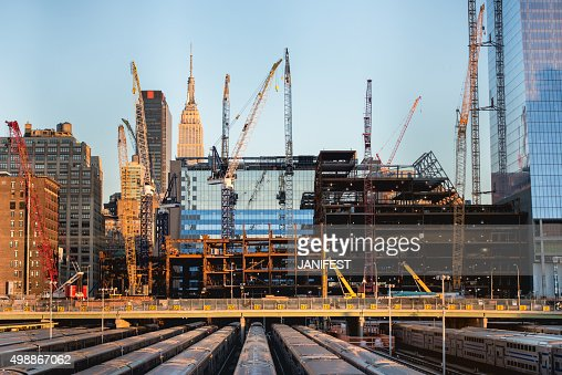 tall buildings under construction and cranes in New York City : Stock Photo