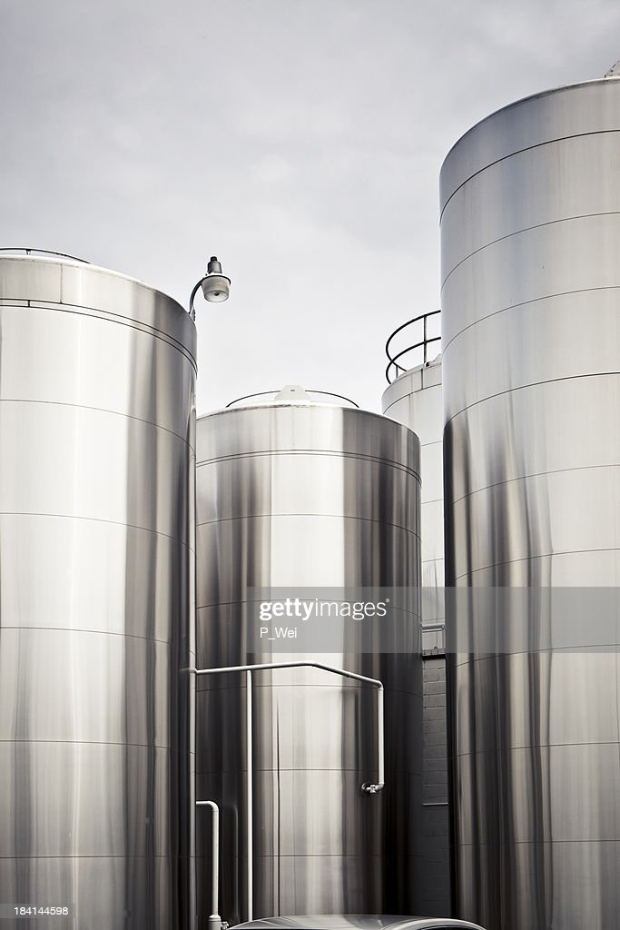 Tall chemical silos for food storage close together