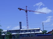 Pictures of tall cranes just south of the James river across from downtown Richmond Virginia. Use to have a lot of Tobacco warehouses in the area. These are now being converted to apartments and condo