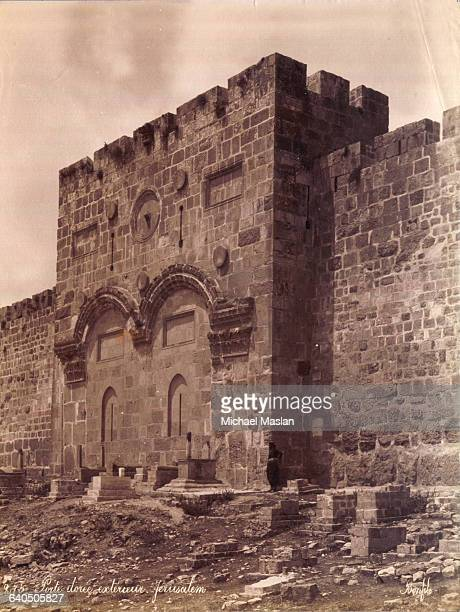 Tall narrow holes in the wall mark the position of arrow slits in a fortified area of the wall surrounding the city of Jerusalem