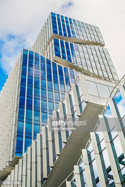A tall office building in the bussiness district of Amsterdam called Zuidas