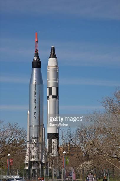 Tall silver rockets under blue skies