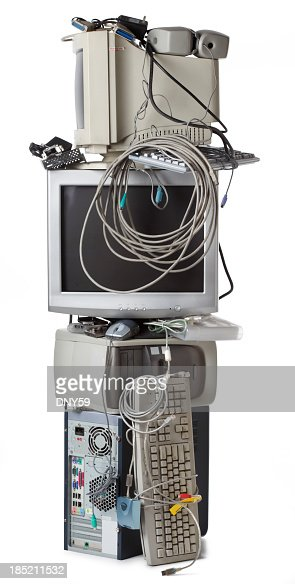 Tall stack of electronic waste on white background