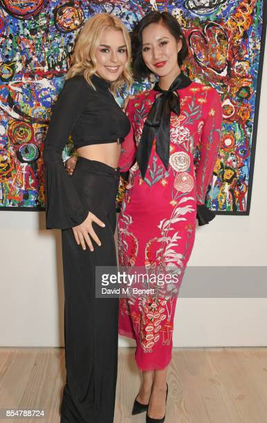 Tallia Storm and Betty Bachz attend the private view and launch of Sacha Jafri's 18 year retrospective global tour 'Universal Consciousnes' at The...