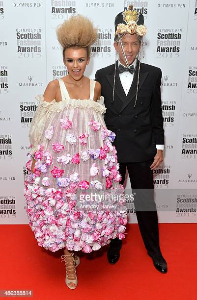 Tallia Storm and Derek Warburton attends the Scottish Fashion Awards at Corinthia Hotel London on September 3 2015 in London England