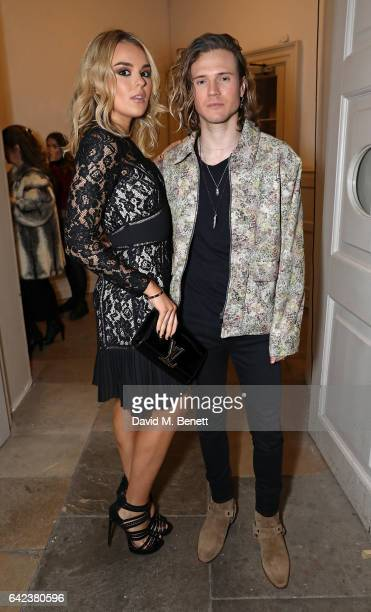 Tallia Storm and Dougie Poynter pose backstage ahead of the PPQ show during the London Fashion Week February 2017 collections on February 17 2017 in...