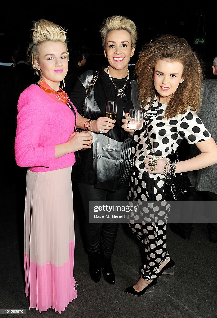 Tallia Storm (R) with sister Tessie Hartmann and mother Tessa Hartmann attend the launch of the Vertu Ti at the London Film Museum, Covent Garden on February 12, 2013 in London, England.