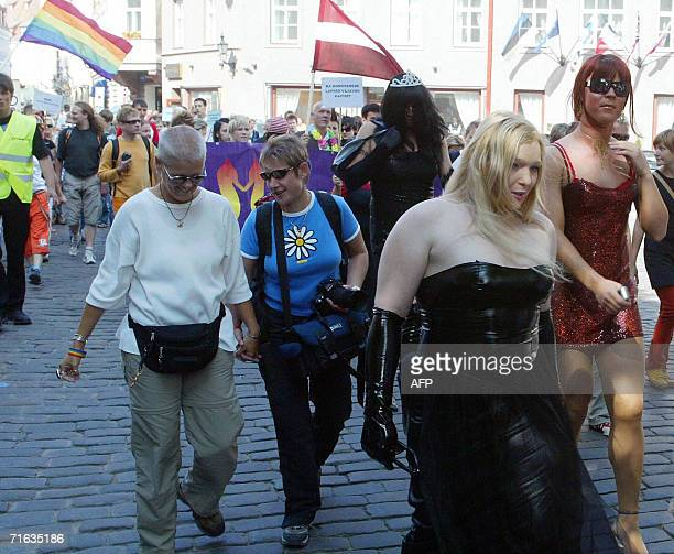 People march during a gay parade 12 August 2006 in Tallinn At least six people were injured during a gay pride march in Estonia on Saturday when...