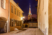 Old stone medieval street in the historic part of the city. Church of St. Olav. Tallinn. Estonia.