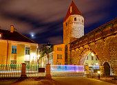 Stone medieval fortress wall around the city at night. Tallinn. Estonia.