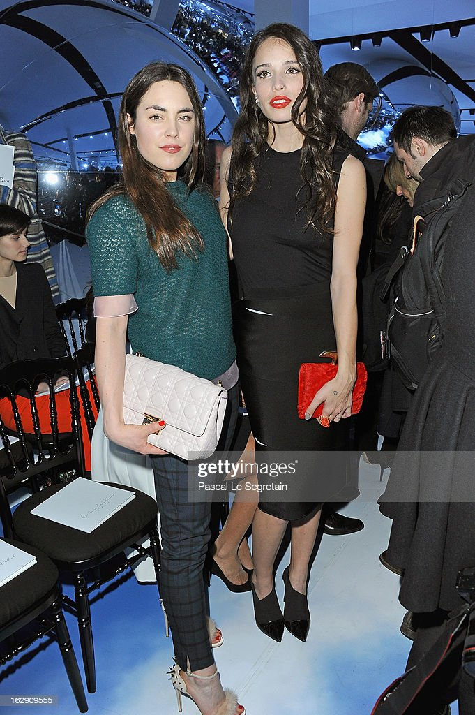 Tallulah Harlech (L) and Chelsea Tyler attend the Christian Dior Fall/Winter 2013 Ready-to-Wear show as part of Paris Fashion Week on March 1, 2013 in Paris, France.