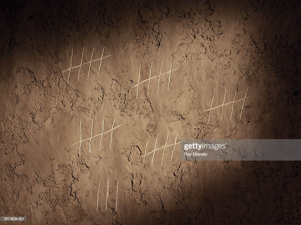 Tally chart scratched onto wall, close-up : Stock Photo