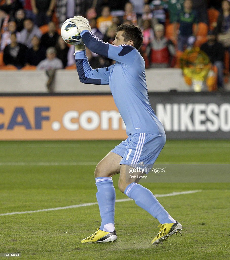 Tally Hall #1 of Houston Dynamo makes a save against Santos Laguna during the second half at BBVA Compass Stadium on March 5, 2013 in Houston, Texas.