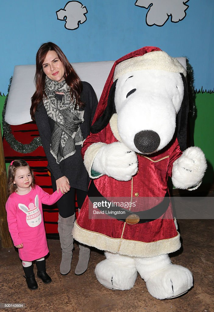 Talulah Price actress Sara Rue and Snoopy attend Knott's Berry Farm's Countdown To Christmas And Snoopy's Merriest Tree Lighting at Knott's Berry...