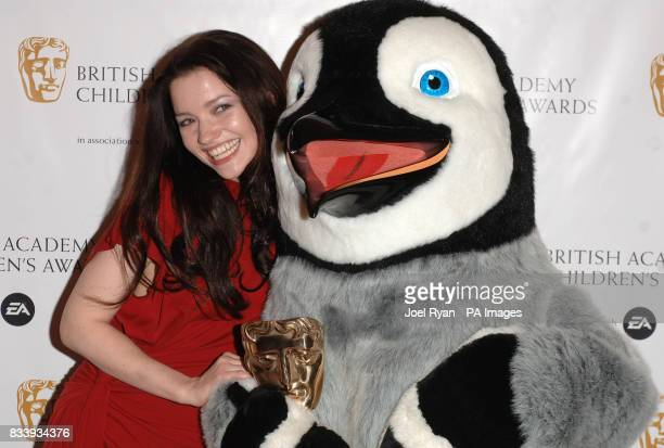 Talulah Riley presents the penguin from Happy Feet the Feature Film award at the British Academy Children's Awards 2007 at the London Hilton Park...