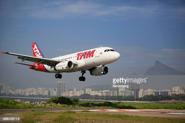 A Tam Linhas Aereas SA jet takes off at the Santos Dumont Airport in Rio de Janeiro Brazil on Tuesday March 31 2015 Brazil's airlines resemble US...