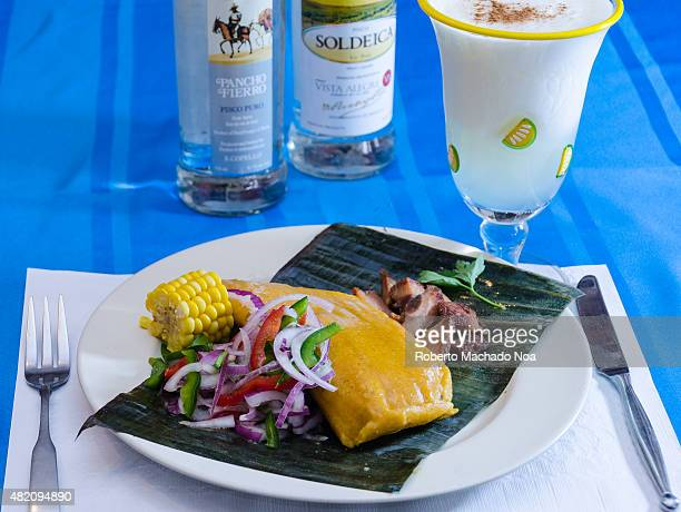 Tamal or tamales and a Pisco Sour cocktail tamales in a corn dough made traditional and popular dish in Latin America