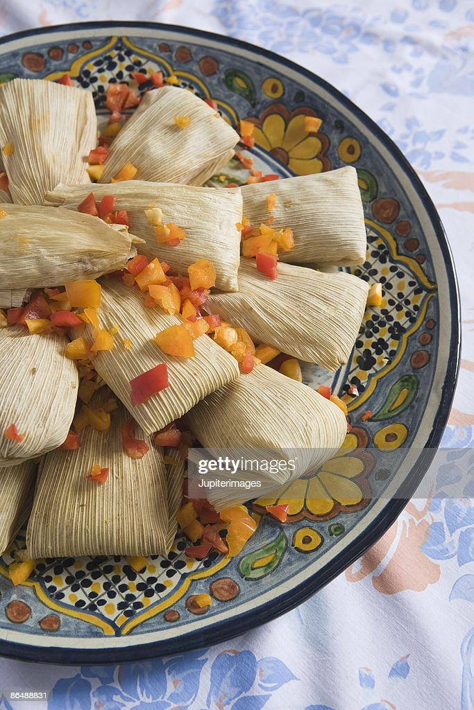 Tamales on decorative plate
