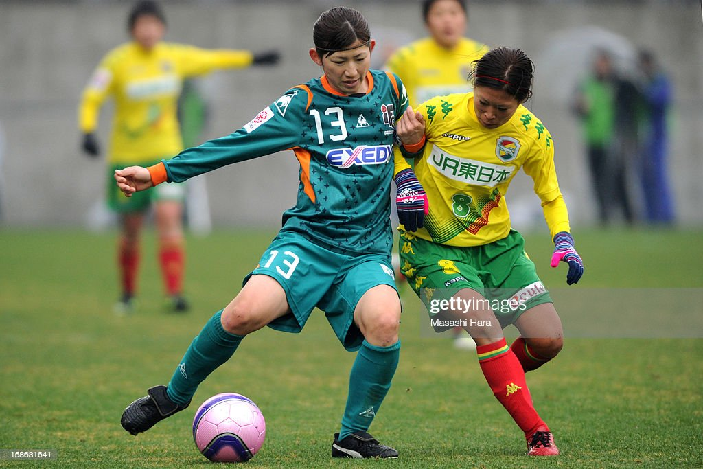 Tamami Miyasako #13 of Iga FC Kunoichi (L) and Risa Fukazawa #8 of JEF United Chiba Ladies compate for the ball during the 34th Empress's Cup All Japan Women's Football Tournament semi final match between Iga FC Kunoichi and JEF United Chiba Ladies at Nack 5 Stadium Omiya on December 22, 2012 in Saitama, Japan.