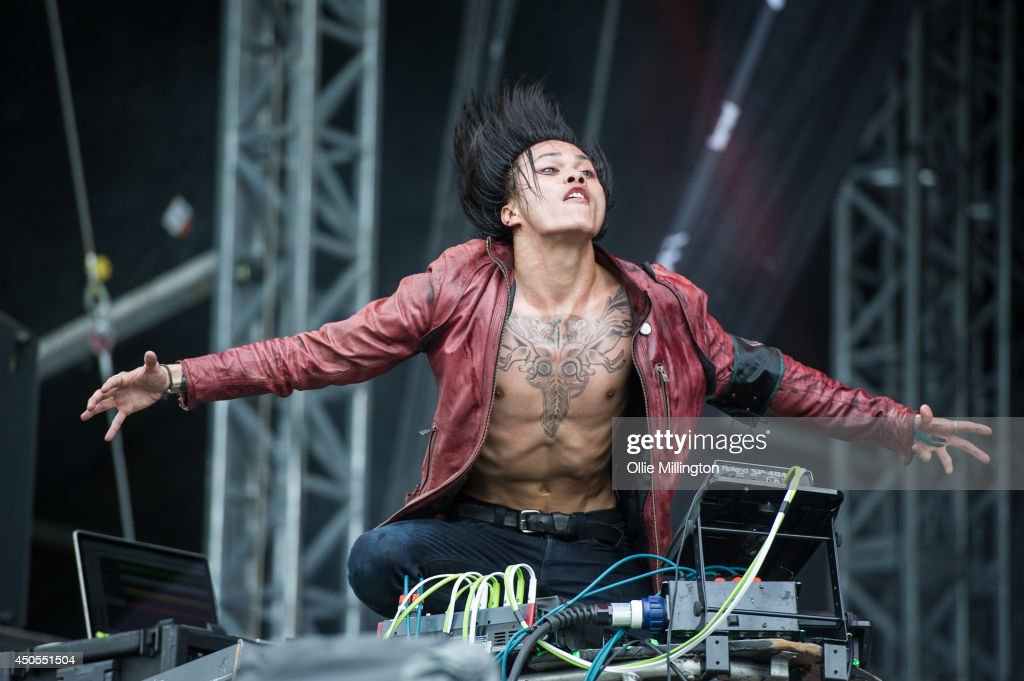 Tamano Terufumi of Crossfaith performs on the main stage at Download Festival at Donnington Park on June 13, 2014 in Donnington, United Kingdom.