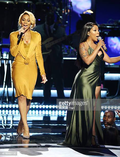 Tamar Braxton and KMichelle perform onstage during the 2015 BET Awards held at Microsoft Theater on June 28 2015 in Los Angeles California