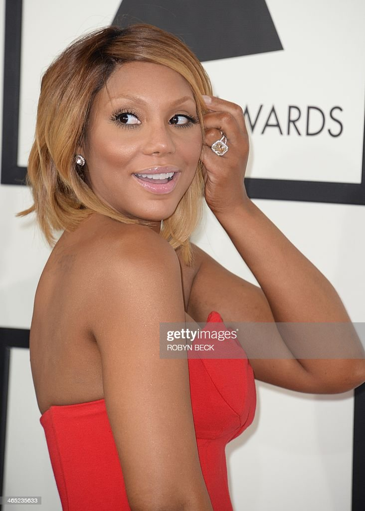 Tamar Braxton arrives on the red carpet for the 56th Grammy Awards at the Staples Center in Los Angeles, California, January 26, 2014. AFP PHOTO ROBYN BECK