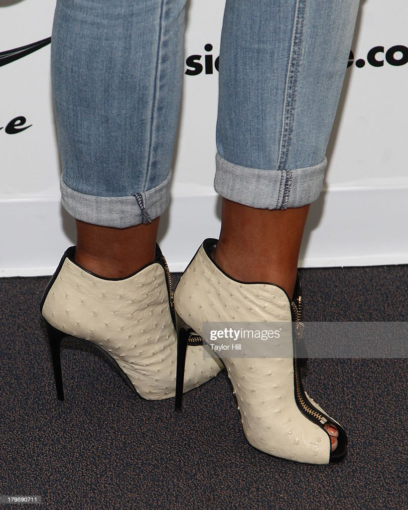 <a gi-track='captionPersonalityLinkClicked' href=/galleries/search?phrase=Tamar+Braxton&family=editorial&specificpeople=2079619 ng-click='$event.stopPropagation()'>Tamar Braxton</a> (shoe detail) visits Music Choice's 'U&A' in Midtown West on September 5, 2013 in New York, United States.