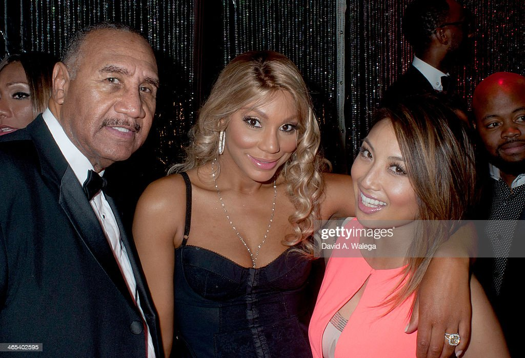 Tamar Braxton (C) with her father Michael Braxton and guest celebrate at Xen Lounge for a Night to Celebrate Tamar Braxton's GRAMMY Nominations on January 26, 2014 in Los Angeles, California.