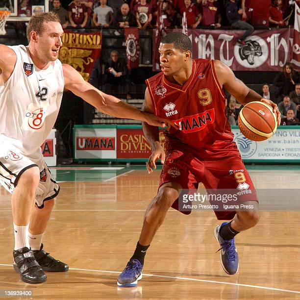 Tamar Slay of Umana competes with Kevin Fletcher of Otto during the Lega Basket Serie A match between Umana Venezia and Otto Caserta at Palaverde on...
