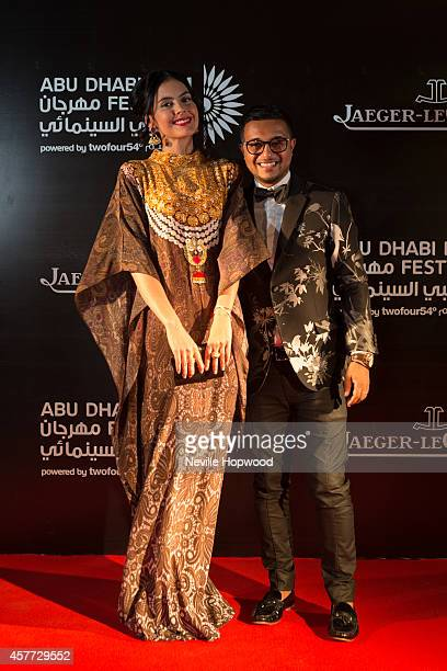 Tamara Al Gabbani and Anish Bhatt attends the opening ceremony of the Abu Dhabi Film Festival on October 23 2014 in Abu Dhabi United Arab Emirates