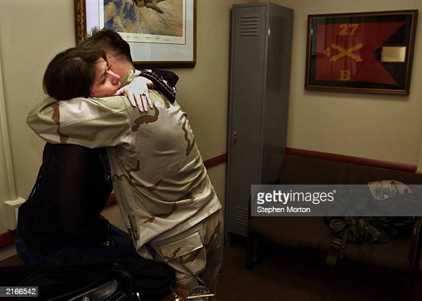 Tamara and Noel Nicolle hug each other in his office after he telephoned his parents before deploying to Kuwait January 10 2003 in Ft Stewart Georgia...
