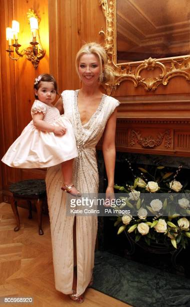 Tamara Beckwith wearing a Bruce Oldfield dress with oneyearold daughter Violet backstage at The Dorchester Hotel for The Goldilocks Fashion Show in...