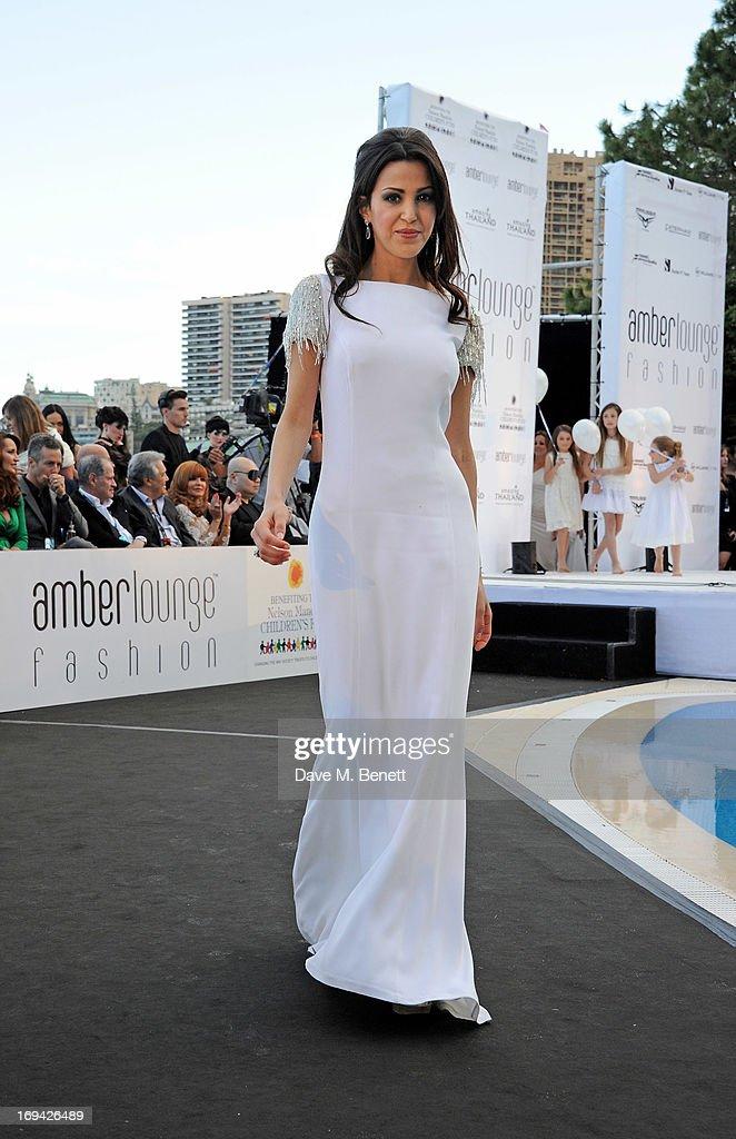 Tamara Boullier walks the runway at Amber Lounge Fashion Monaco 2013 at Le Meridien Beach Plaza Hotel on May 24, 2013 in Monaco, Monaco.