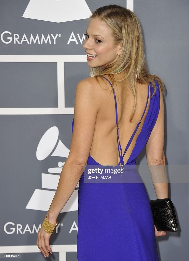 Tamara Braun poses on the red carpet at the Staples Center for the 54th Grammy Awards in Los Angeles, California, February 12, 2012. AFP PHOTO Joe KLAMAR