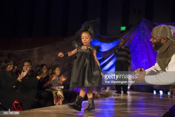Tamara Dade 4 heads toward the end of the runway where loud cheering including her grandfather Rico Johnson greets her at the 3rd Annual Glynn...