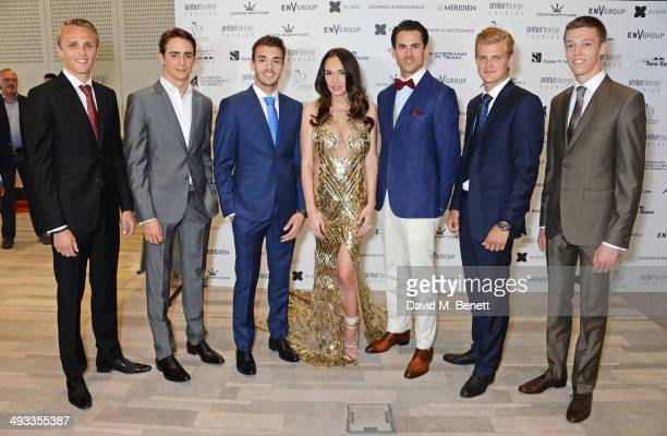 Tamara Ecclestone poses with F1 drivers Max Chilton Esteban Gutierrez Jules Bianchi Adrian Sutil Marcus Ericsson and Daniil Kyvat at the Amber Lounge...