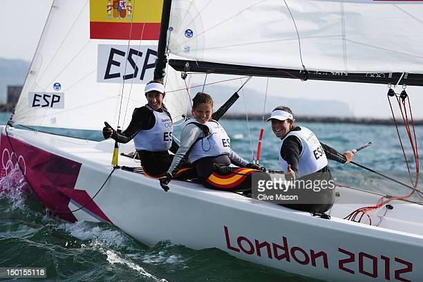 Tamara Echegoyen Dominguez Sofia Toro Prieto Puga and Angela Pumariega Menendez of Spain celebrate finishing first to win the gold medal in the...