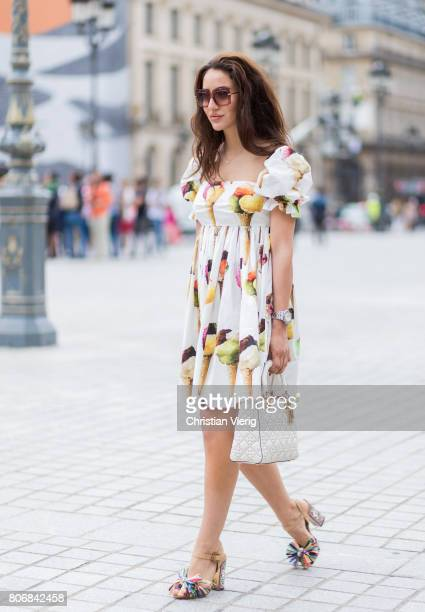 Tamara Kalinic wearing Dolce Gabbana dress Dior bag outside Schiaparelli during Paris Fashion Week Haute Couture Fall/Winter 20172018 Day Two on July...