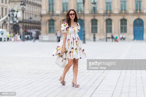 Tamara Kalinic wearing Dolce Gabbana dress Dior bag outside Schiaparelli during Paris Fashion Week Haute Couture Fall/Winter 20172018 Day Two on July...