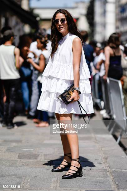 Tamara Kalinic wears a ruffled white dress outside the Jean Paul Gaultier show during Paris Fashion Week Haute Couture Fall/Winter 20172018 on July 5...