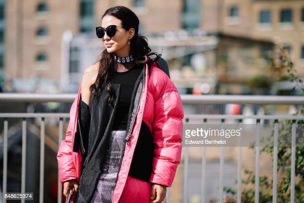 Tamara Kalinic wears sunglasses a Versus full outfit a pink puffer coat outside Versus during London Fashion Week September 2017 on September 17 2017...