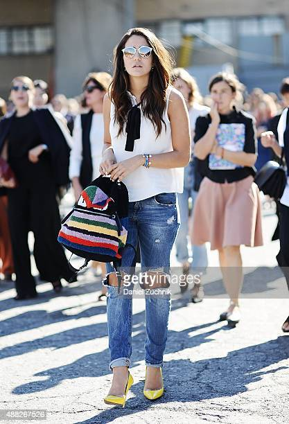 Tamara Kallinic is seen outside the 31 Phillip Lim show wearing an Asos top Paige Denim jeans Dior glasses Jimmy Choo heels and a Fendi backpack...