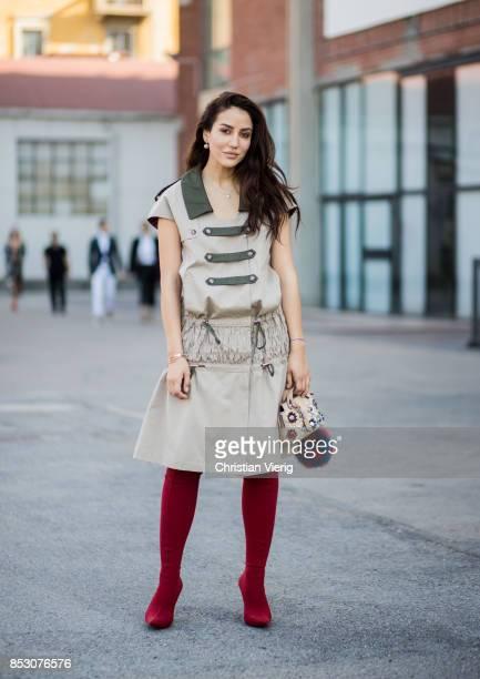 Tamara Kilic wearing red overknees Fendi bag is seen outside Au Jour Le Jour during Milan Fashion Week Spring/Summer 2018 on September 24 2017 in...